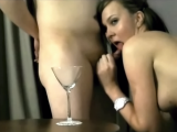 Cute brunette drinks cum from a glass after blowjob