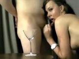 Cute brunette drinks cum from a glass after blowjob
