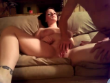 Pounding her pussy on the couch