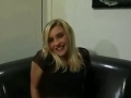 Smiling blonde sucking and fucking in both holes on a leather sofa