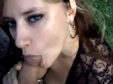 Wife gives a blowjob outside on the grass