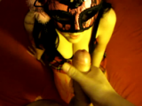 Masked girl on knees get a facial and sucking dick clean