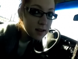 Cute chick in glasses gives a blowjob in the car