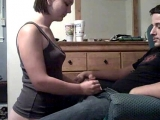 Girlfriend on her knees giving her boyfriend some head on webcam