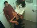 Hidden bathroom security cam catches a guy getting blowjob from a horny girl